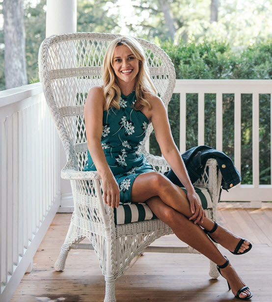 Reese Witherspoon in green floral print dress on patio for Draper James